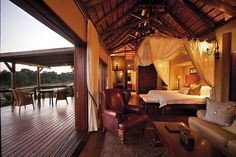 Watch wildlife from your luxury suite at this African-themed safari lodge, set in a private Big 5 concession within the Kruger Park. Kruger National Park, National Parks, Game Reserve South Africa, Sand Game, British Colonial Decor, Game Lodge, River Lodge, Private Games, Luxury Camping