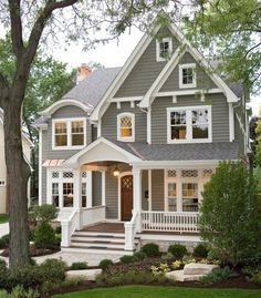 Love the coloring, porch and side addition. Also love the introduction of a few curves (door, gable, porch entrance)in the house to soften the exterior's triangular edges
