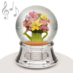 "Musical Water Globe - Floral Bouquet - Featuring a lovely floral bouquet in a watering can, this musical water globe will make a bright and cheery gift for any special person in your life. It is sure to be treasured when you add your own engraved message to it. When wound it plays the song ""Top of the World."" The ideal gift for ANY occasion."