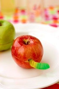 "Apple surprise!  Slice an apple, carve a ""hole"" lengthwise to lay a gummy worm through, spread both flat ends of the halves with peanut butter and seal it up!"