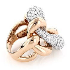 Unique Diamond Cocktail Rings: This 18K Gold Two Tone Designer Diamond Ring weighs approximately 18 grams and showcases 5.6 carats of sparkling round diamonds. Featuring a fabulous design and a highly polished gold finish, this diamond fashion ring is available in 18K white, yellow and rose gold and makes a great gift for a special occasion.