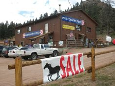 This is a awesome place in the mountains west of Denver!    One stop shopping for all of your livestock and pet needs. Wonderful selection of tack, saddle pads, blankets and consignment saddles of all styles. Don't forget to stop upstairs because we have gifts, home décor, art and furniture to compliment your western or rustic lifestyle. New cowgirl boutique, jeans, tops, tees and accessories!            TEXT: PINEFEED TO: 33938 For Additional Savings http://pinecountryfeed.com/