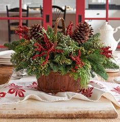 28 Christmas Centerpieces to Welcome House Guests Canella Berry Table Basket #Gifts #Centerpiece #ChristmasCenterpiece #Christmas #Decor #ChristmasEvergreens