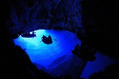 Blue Cave, Croatia  This spectacular blue cave or grotto can be found on the remote limestone island of Bisevo in Croatia. The Blue Cave is at its most beautiful between 11am and noon when the sun's rays pass through an underwater opening to create a beautiful blue light. Boats can be taken inside the cave, but for a surreal experience you should take an underwater swim to see the rocks glimmer in silver and pink.