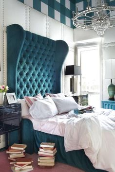 Padded walls with studs, dramatic turquoise tufted headboard and that matching plaid headboard. design by Brian Patrick Flynn glam bedroom