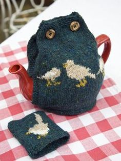 Knit this homeware tea cosy, with intarsia little bird detail, from Cute Little