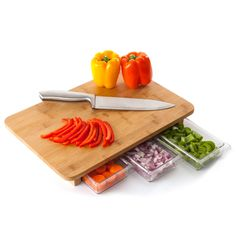 Cutting board with three prep containers built in.  What a great idea! Perfect for people with limited counter space.
