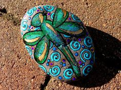 9 beautiful ways to paint a rock