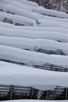 Snowboard photo: Bataleon Snowboards' Brendan Keenan airs down a crazy deep pillow line in Niseko, Japan. Photo by Jeff Patterson.