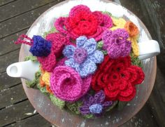 Spring Explosion Tea Cozy!   Crochet with Raymond yes hiding under all these gorgeous flowers is a teapot!!