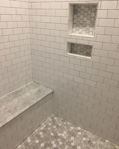 "So after almost 9 years of having to use a super tiny (I'm only 5'0"" so you know it's small) shower stall, I'm crazy excited about this huge shower with dual shower heads! Shower details- talking mosaics and pencil lines and bands... it had my head spinning! I already confessed that tile was one area in the home I never had a vision for. So I decided to keep it simple: The whitest subway tile to let the pretty marble hex floor and honed marble seat shine. It will be grouted tomorrow with the..."