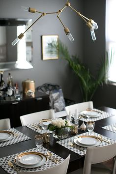 A gray & black dining room with gold accents