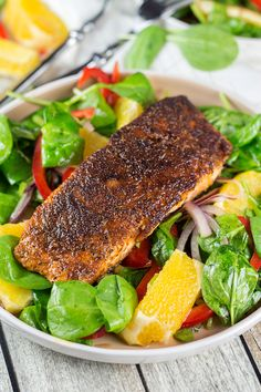 How to Make Blackened Salmon + a wonderful spinach, orange, and red onion salad which combines with it perfectly! | yummyaddiction.com
