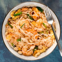 Shrimp Pad Thai | This lightened Pad Thai is packed with vibrant ingredients like crushed red pepper, sliced green onions, and dry-roasted peanuts to add great flavor.