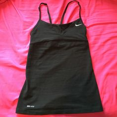 Nike dri-fit tank! Mesh back w/ adjustable straps Brand new without tags! This top is perfect for exercising. The mesh back makes this Nike dri-fit top super cool and airy! Nike Tops Tank Tops