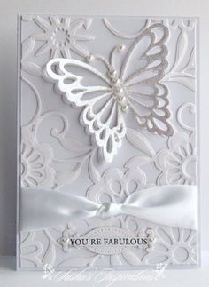 BUTTERFLY MAGIC SPELL BINDERS | white on white throughout. I added some glimmer dust to my butterfly ...