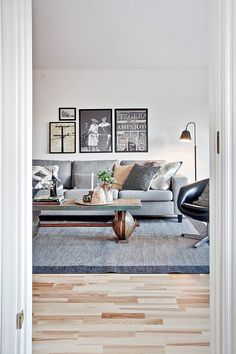 Prints organisation in wall, lamp, sofa and chair positioning, rug, coffee table tray