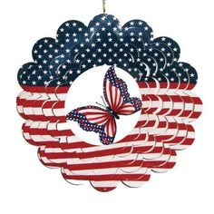 """American Flag Style Butterfly Painted Metal Spinner 12"""" Dia Patriotic USA by VictorianDisplay. $19.99. 12"""" Diameter. Great home and garden decoration. Made from metal. Scalloped edge design. Painted designs. Enhance your home and garden with this beautiful metal spinner. Features painted designs on both sides. When a breeze comes along, the spinning design will surely be a delight!"""