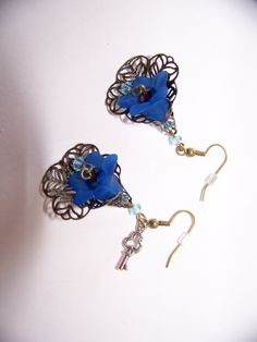 Blue Filigree Earrings by Mrsflobbernoodle on Etsy, $7.95