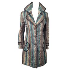 Glen Arthur Python Coat With Silk Lining and Suede Detail   From a collection of rare vintage coats and outerwear at https://www.1stdibs.com/fashion/clothing/coats-outerwear/