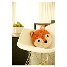 Fox Crochet Throw Pillow in Orange hanging out in an Eames chair. Thats how we roll.