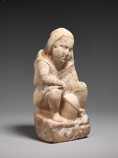 Marble statuette of a slave boy with a lantern Period: Imperial Date: 1st or 2nd century A.D. Culture: Roman
