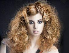 Possible hair:   - big, curls, teased, messy.   - definitely high fashion