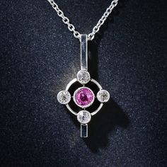 "This delightful vintage platinum-over-gold pendant features a luscious raspberry sapphire at its center and at points north, south, east and west sparkling antique-cut diamonds. A stylish and feminine keepsake to wear everyday, suspended on a 16"" platinum cable chain with a sturdy clasp."