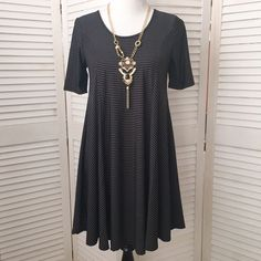 Black & taupe stripe boutique swing dress I wish you could feel this fabric! Beautiful hand, beautiful drape. Will go anywhere, a perfect travel dress. Black and taupe striped smooth jersey knit. Perfect amount of stretch. Jewel neck, short sleeves. Flattering trapeze silhouette. Marked size L. In my opinion, runs a bit small. I'm going to say it will fit a L, but will fit a M best. NWT; never worn. Boutique Dresses