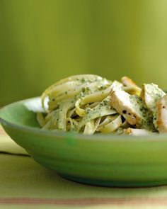 *Chicken Fettuccine with Pesto Cream Sauce*      3 boneless, skinless chicken breast halves (6 to 8 ounces each)*     Coarse salt and ground pepper*     1 tablespoon olive oil*     1/2 pound fettuccine     1/2 cup frozen Basil Pesto*     1/4 cup heavy cream*