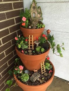 Sweet multi tiered fairy garden planter!