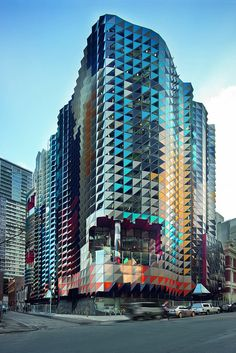This is the Side View of SAB RMIT, it shows a lot more colours than the front really, and it sort of gradients across the face.  The building and shape of the panels set it aside from millions of buildings around the world, and tells people passing by 'we're creative. We're RMIT University.'
