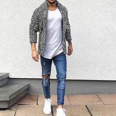 Try teaming a grey shawl cardigan with blue distressed slim jeans to create a great weekend-ready look. A pair of white high top sneakers brings the dressed-down touch to the ensemble.   Shop this look on Lookastic: https://lookastic.com/men/looks/grey-shawl-cardigan-white-crew-neck-t-shirt-blue-skinny-jeans/21074   — Grey Shawl Cardigan  — White Crew-neck T-shirt  — Blue Ripped Skinny Jeans  — White High Top Sneakers