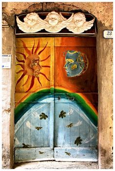 Valloria, Liguria Region, Italy. Valloria is a small village in the mountains close to Imperia. It is singular in that all doors in the village are paintings.