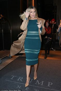 She's OK! Khloe Kardashian looked typically sensational as she stepped out of her hotel in New York on Wednesday, hours after her flight to the city had to take an emergency landing in Las Vegas