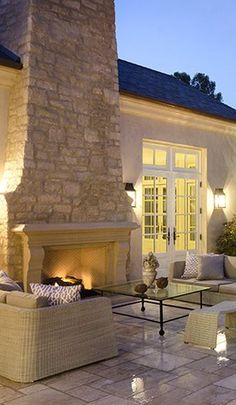 Patio With Outdoor Fireplace And Wall. #patios #outdoorliving