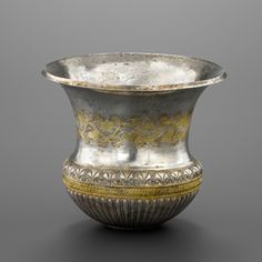 Achaemenid Gilded silver Bowl With Incised Garlands                                                                                                                                                        Culture :                  Greek                                              Period : late 4th-early 3rd century B.C. (ca. 300 B.C.)