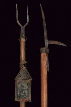 A pike pole and a poled fork Italy, 16th Century  The first one with iron cusp and hook. The fork provided with two prongs, a spike and a hook. Provided with a lantern for night hiking.