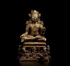 A silver and copper inlaid copper alloy figure of Buddha, Kashmiri, circa 8th century