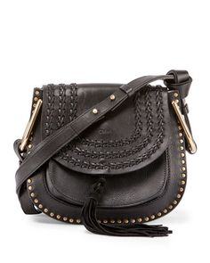 Chloe calfskin and napa lambskin shoulder bag with golden hardware. Studs frame exterior of horseshoe-shaped body. Adjustable shoulder strap with large U-shaped rings. Woven detail and logo embossing