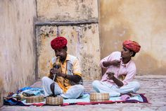 Snake charmers sitting within the walls of the Amber Palace in Jaipur, India. Snakes really creep me out, so I didn't dare get too close. It was a moment I was thankful for my zoom! I think this photo really captures the essence of our time in India. #incredibleindia #culture #wow