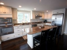 """Like the look of these cabinets.  Might try this in my kitchen by """"remodeling"""" the cabinets I have with moulding, wood, primer, and paint."""