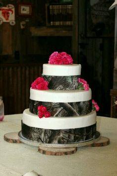 Camo cake. Cute!  I would do purple flowers too