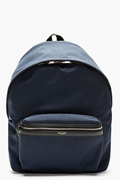 SAINT LAURENT // NAVY LEATHER-TRIMMED BACKPACK $1075