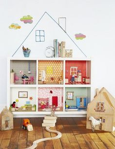 Love the use of the IKEA expedit piece as a dollhouse. Wish I could find the original source.