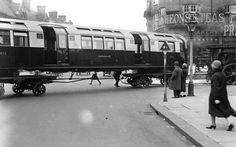 1926: An underground train is transported on wheels through the streets of London.