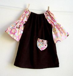 size 2t... soft chocolate corduroy with pink cotton long sleeves