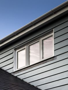Cement cladding surrounding a window on a residential property in Surrey, UK. Hundven-Clements Photography