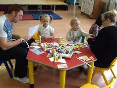 This is a picture of children and teacher doing activities together. They learn how to work and ask the teacher when they are doing something and they know where to go if they are in any trouble which helps them to settle in easily.