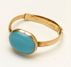 "Jane Austen's gold and turquoise ring, auctioned by Sotheby's. It was initially thought to be odontolite (""bone turquoise""), fossilized ivory heat-treated to imitate real turquoise, but tests conducted found the blue cabochon to be real turquoise. Source: Sotheby's: July 10, 2012 - Lot 59, Catalogue Notes & Provenance"